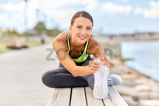 happy young woman doing sports and stretching leg
