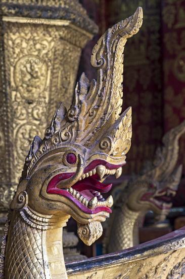 Naga serpent head with menacing fangs, Temple Wat Xieng Thong, Luang Prabang, Laos