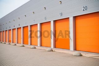 small business units with orange roller doors