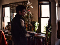 Young man playing drums in cozy room