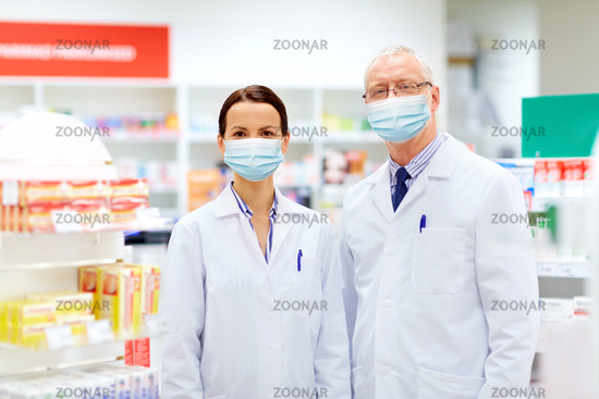 apothecaries wearing medical masks at pharmacy