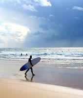 Surfer surfboard beach rain Portugal