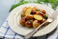 Young baked potatoes with salt and dill.