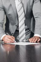 Businessman signing contract document
