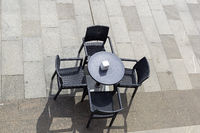 A street cafe - a table and four chairs.