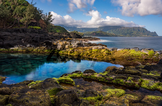 Long exposure image of the pool known as Queens Bath on north shore of Kauai