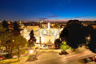 Rome. Piazza del Popolo or Peoples square and eternal city of Rome evening view