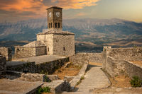 Sunset over clock tower and fortress at Gjirokaster castle, Albania