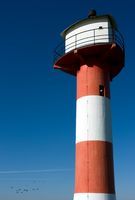 Lighthouse in front of blue skies