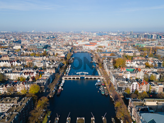 Amsterdam, The Netherlands, 7th November 2020 Aerial view of the Magere Brug Amsterdam And the river Amstel, City hall and Hermitage autumn