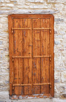 Old wooden door in the stone house of Cyprus.