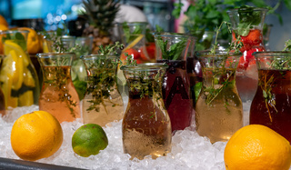beautiful homemade hearbal tea infusions on ice with fruit and condiments