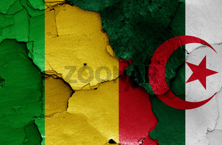 flags of Mali and Algeria painted on cracked wall
