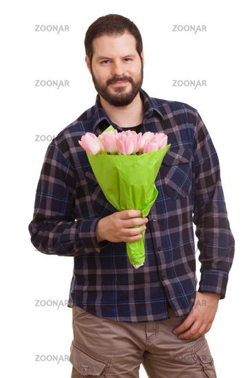 Bearded young handsome man holding a bouquet of pink tulips, isolated on white background. Mothers day, Valentines day, Easter and surprise Concept.