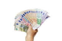Right hand holding various Euro banknotes, fanned out, isolated on white background. Money, insurance, wealth concept.