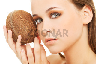 Attractive young woman with coconut. Closeup.