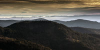 Wind turbines on the Black Forest mountains with a view of the Swiss Alps