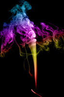 Abstract multicolored smoke on a dark background