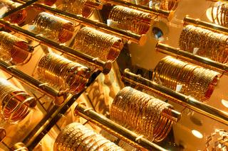 Golden bracelets in a jewelery shop
