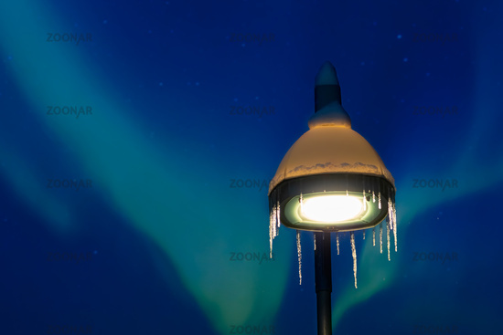 Street lamp and northern lights