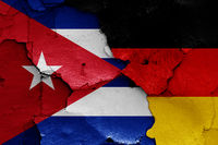 flags of Cuba and Germany painted on cracked wall