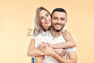 Happy smiling couple in love on beige background