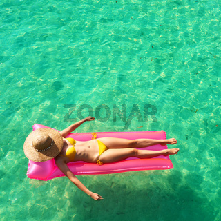 Woman relaxing on inflatable mattress