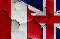 flags of Peru and UK painted on cracked wall