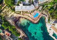Drone point of view Cala Vinyes, green transparent water bay of Mediterranean Sea. Majorca, Espana, Spain