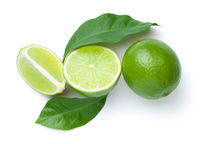 Limes With Leaves Isolated On White Background