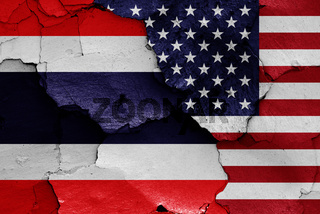 flags of Thailand and USA painted on cracked wall