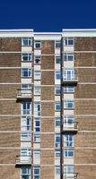 a view of a typical british council built high rise apartment block typical of public housing in the uk