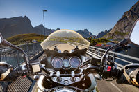 Biker rides on road in Norway. First-person view.