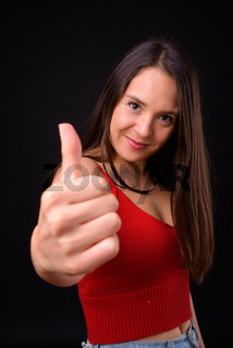 Young multi ethnic beautiful woman against black background