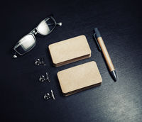 Business cards, pen, glasses