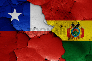 flags of Chile and Bolivia painted on cracked wall