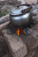 Cooking in a clay rocket kitchen in M'Hamid El Ghizlane