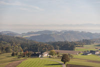 Distant view in the Upper Danube Valley - farms and hilly landscape, Austria
