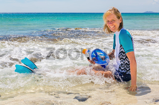 Dutch woman sits in sea with snorkel mask