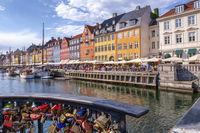 Padlocks and colorful buildings of Nyhavn in Copenhagen, Denmark