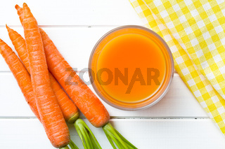top view of carrot juice in glass