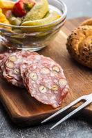Sliced italian salami with hazelnuts.