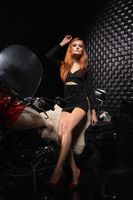 Cute red-haired woman posing in the studio