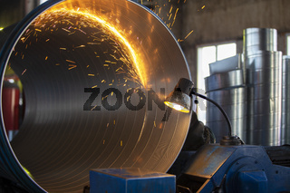 Production of ventilation metal pipes. Metal welding. Metal industry.