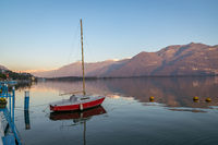 red boat on stunning mountain Iseo lake