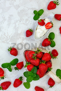 Ripe strawberries in a ceramic jug.