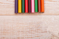 Colorful pencils on white wooden background. Top view and education concept. Copy space and mock up