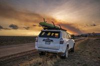 Toyota 4runner SUV  and wildfre smoke plume