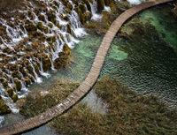 Diagonal Wooden Catwalk by Waterfalls