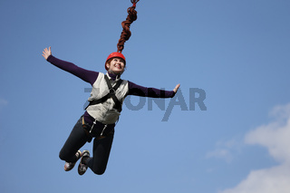 Jumping with a rope.Bold woman jumping with a roped .Crazy hobby of an elderly woman